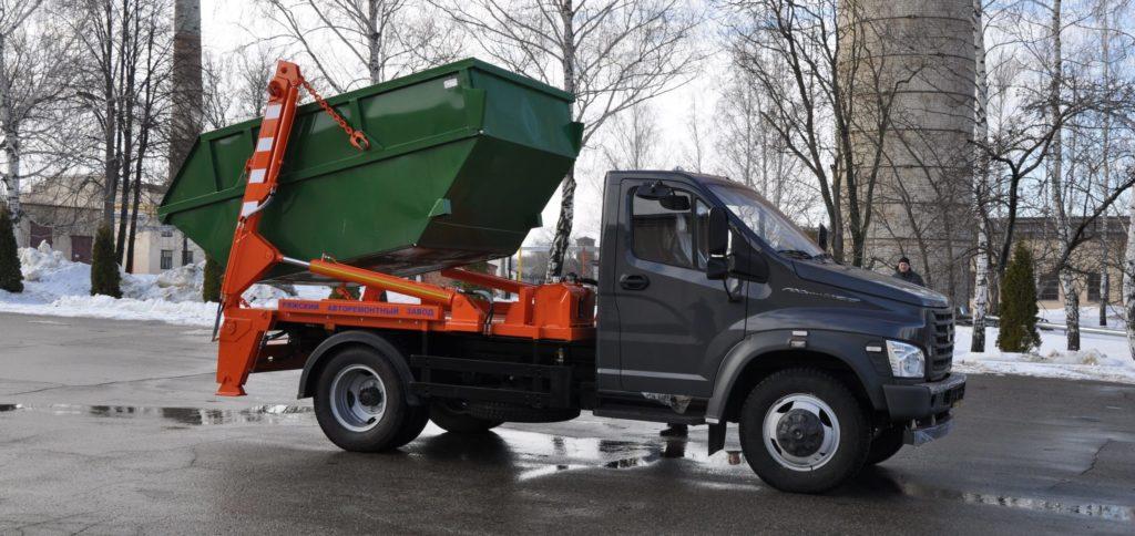 Вывоз мусора контейнером 8м3 - фото